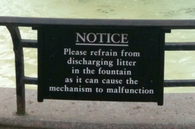 Sign: please refrain from discharging litter in the fountain...