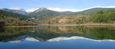 Gredos mountains reflected in reservoir