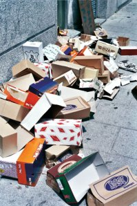 shoe boxes left behind after a street market