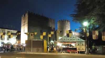 medieval fair with castle backdrop