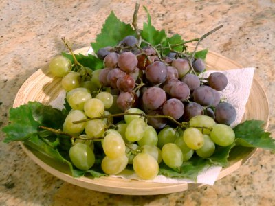 black and white grapes on a dish