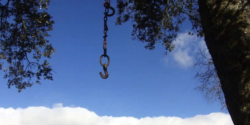 hook & chain silhouette against sky