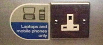 "power socket in train: ""laptops and mobile phones only"""