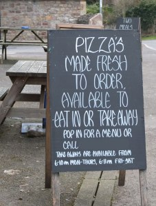 "Pub sign ""Pizza's made fresh"""
