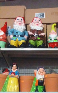 garden gnomes (Snow White & the Seven Dwarfs) on shop shelf