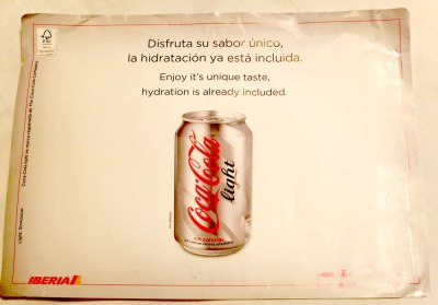 Coke ad text: Enjoy it's unique taste, hydration is already included