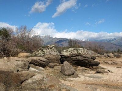 rocks on the shore of embalse Rosarito, reservoir Spain