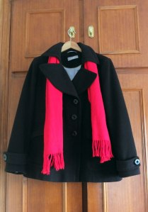 Black jacket & red scarf