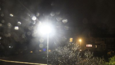 street lamp refracted through rain drops
