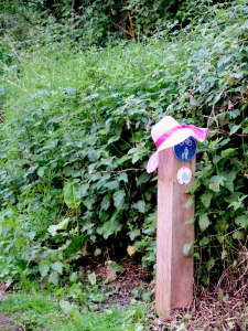 Bridleway marker with summer hat