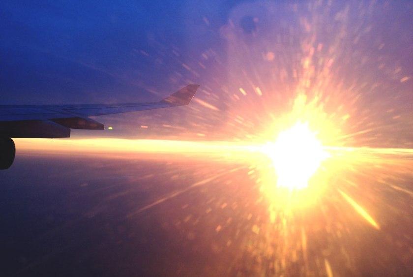 sun set light stream from plane window