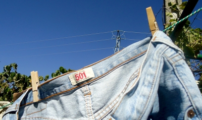 Levis 501s faded jeans hanging on  washing line