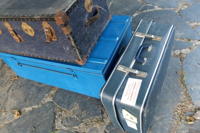 Two old trunks and a suitcase