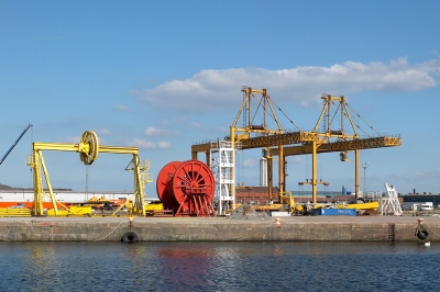 orange, yellow and white machinery & metal structures on Firth of Forth dockside