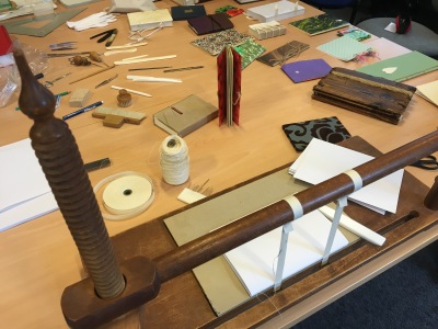 bookbinding tools and hand-made pamphlets