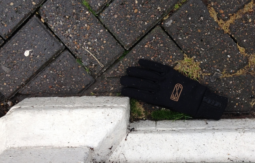 single black monogrammed glove