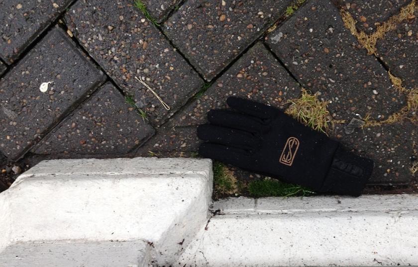 single black monogrammed glove