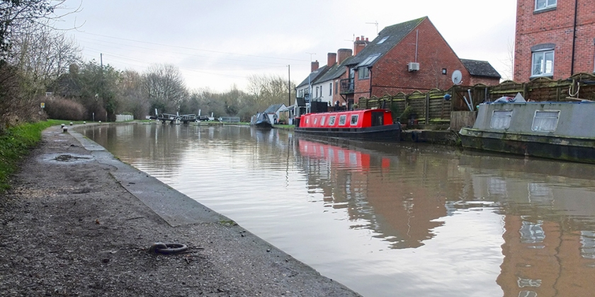 red canal boat moored on Grand Union Canal