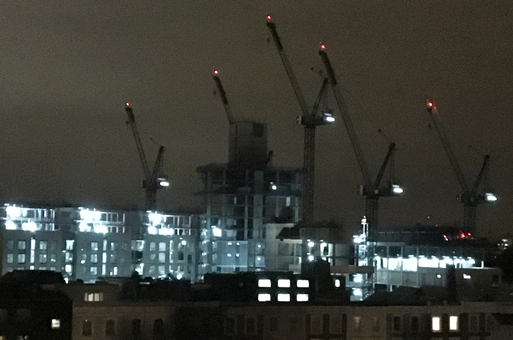 London. Night skyline with cranes.