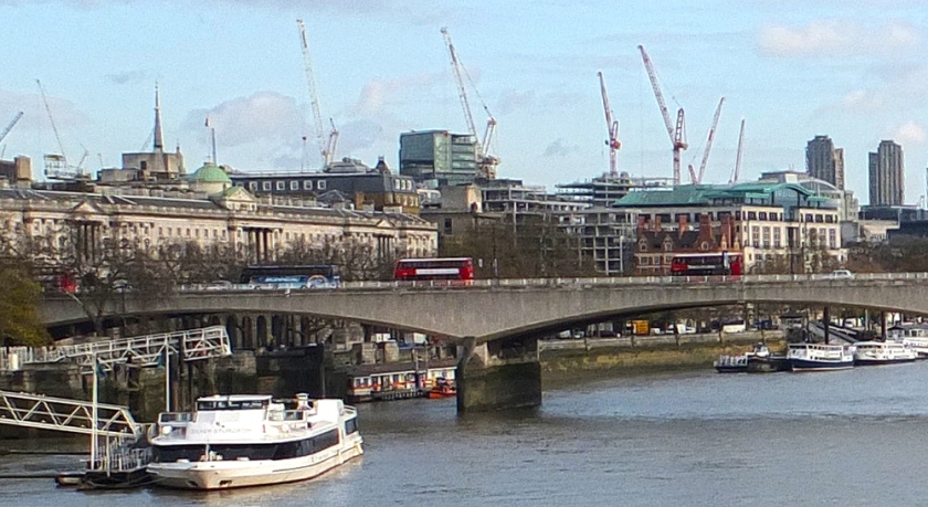 River Thames, London. Skyline with cranes.