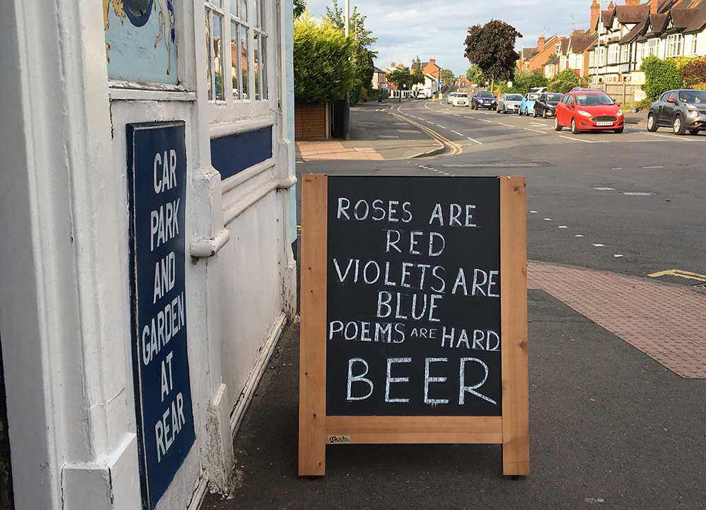 """poems are hard"" quotation on pub chalkboard"