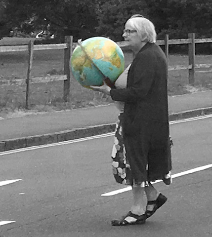Elderly woman carrying a globe