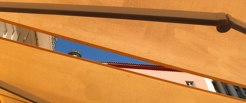 Gap in awning showing blue sky