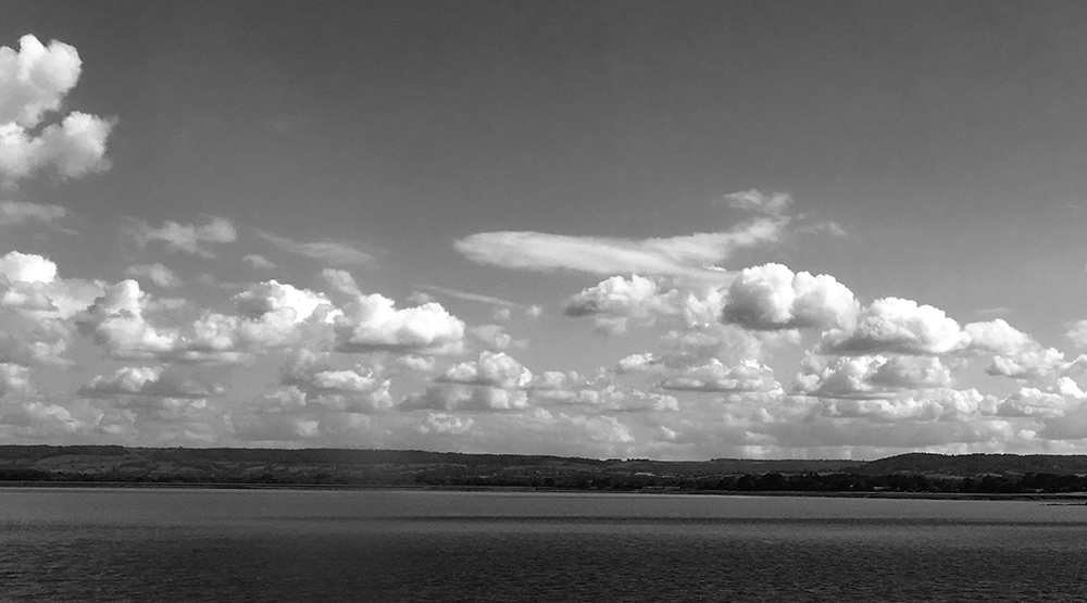 clouds and sky over Servern Estuary. Black and white
