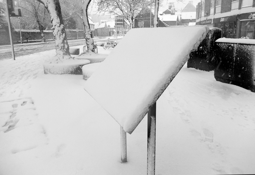 street sign covered in snow