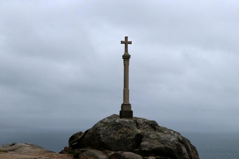 single monumental cross against grey sky
