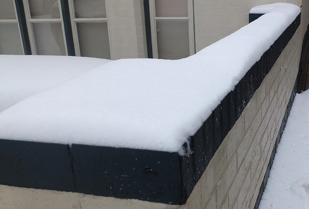 snow on top of wall