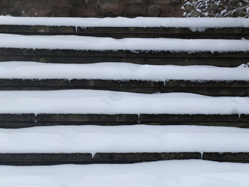 snow settled on outdoor steps