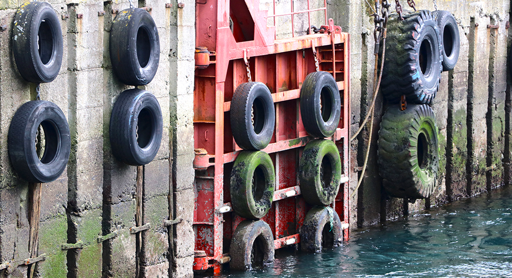 tyres on harbour wall