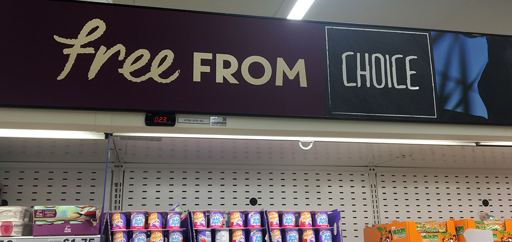 "Supermarket shelf advertising ""Free from: Choice"""