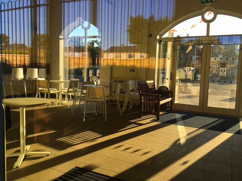 Empty railway indoor café. Bright sunshine