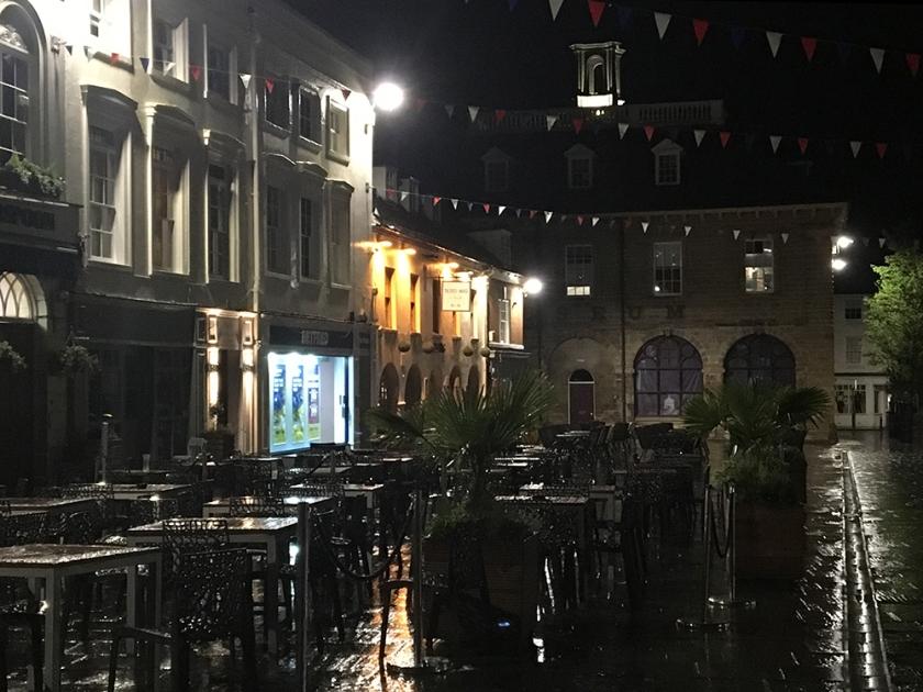 Rainy night. Empty pavement café