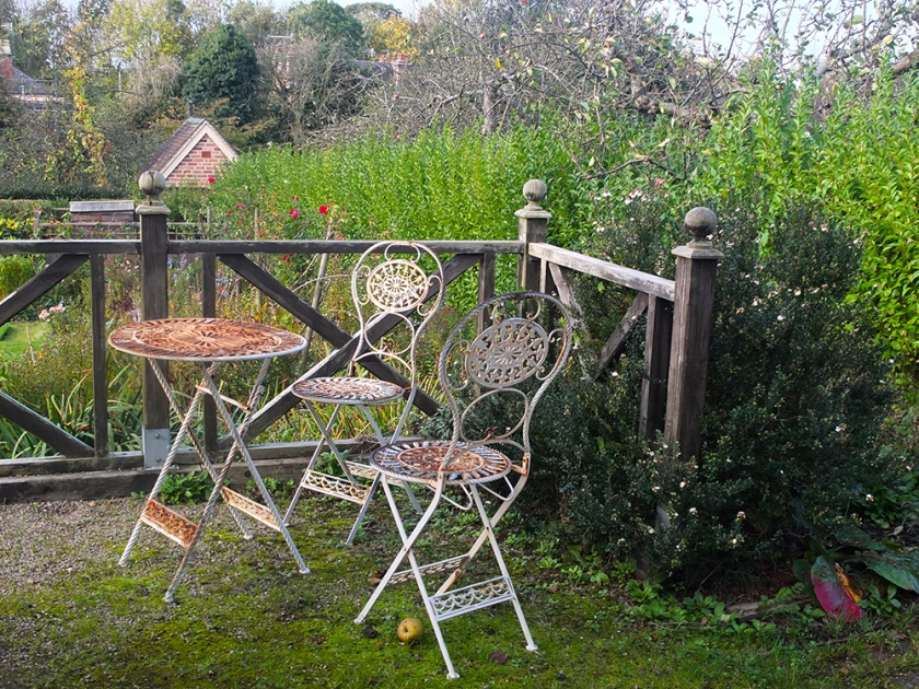 Rusty bistro-style chairs and table