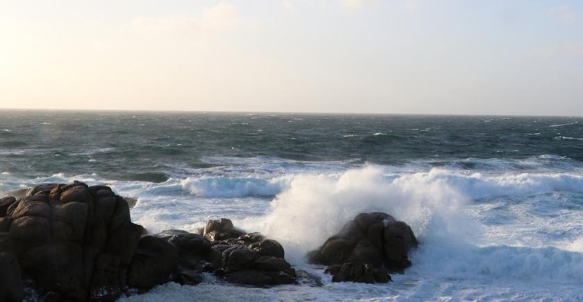 Waves break against rocks on Galician coast