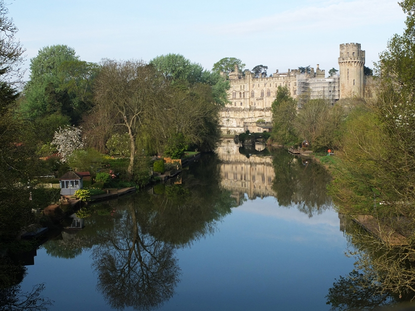 Warwick castle reflected in River Avon