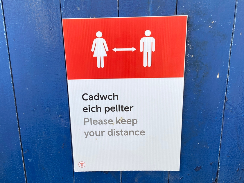 social distance poster Welsh and English
