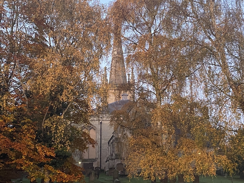 Church steeple and autumnal trees