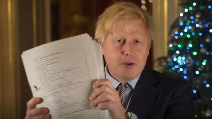 Boris Johnson brandishing  Brexit agreement