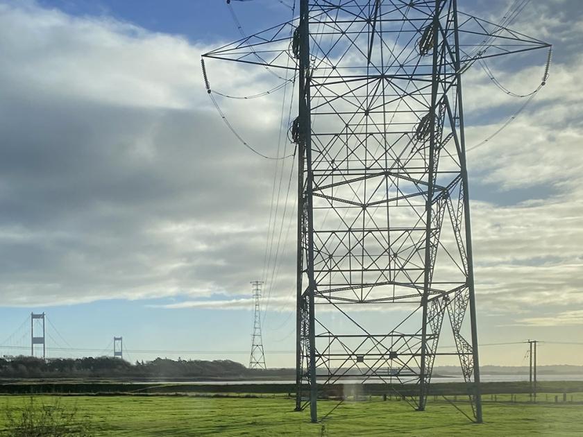 Pylon. Severn estuary in background