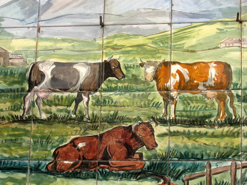 painted tiles. Cattle grazing