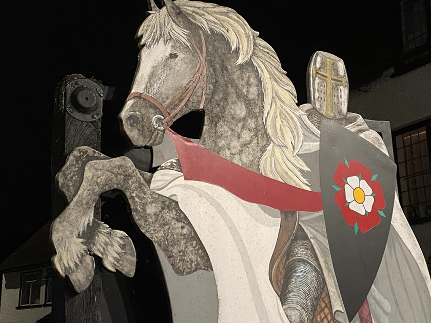 knight in armour on horse painted sign