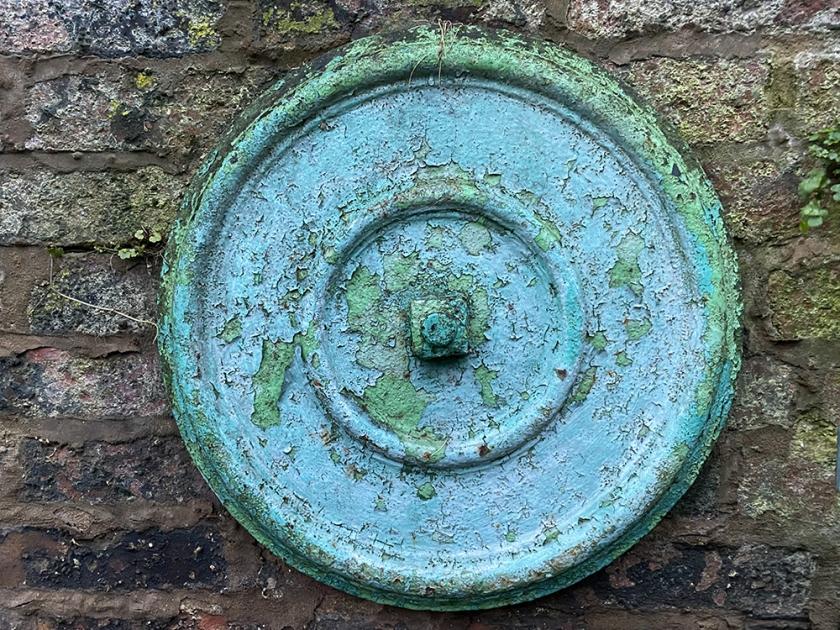 old metal circular wall anchor