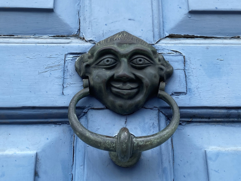 old door knocker with face