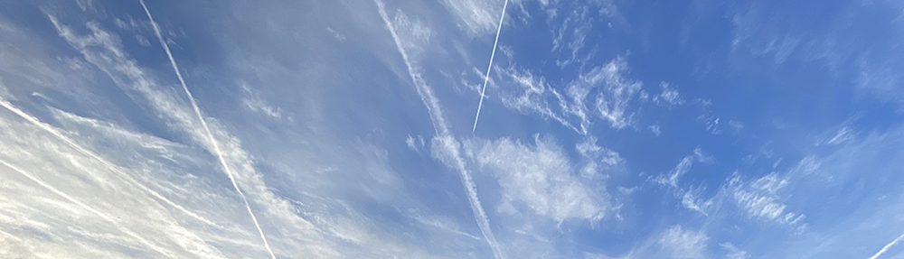sky with cirrus and contrails